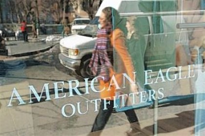 AMERICAN EAGLE Pedestrians walk past an American Eagle Outfitters store.
