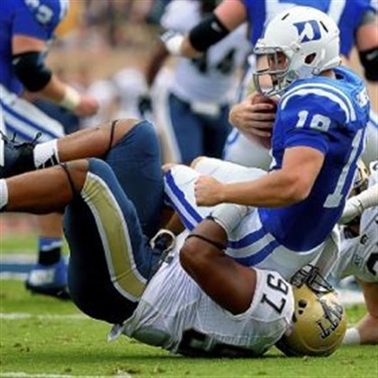 pittfb2 Pitt's Aaron Donald sacks Duke quarterback Brandon Connette Saturday during a game earlier this season in Durham, N.C.