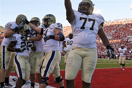 Dion Lewis and Jason Pinkston Pitt offensive lineman Jason Pinkston (77) celebrates a touchdown by running back Dion Lewis (28) in a game against Utah in September 2010.