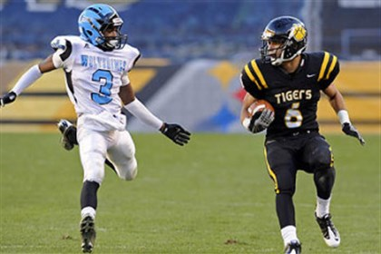 North Allegheny's Elijah Zeise carries football North Allegheny's Elijah Zeise, right, and Woodland Hills' Trevon Mathis