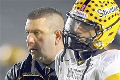 Montour Montour coach Lou Cerro consoles Devin Wilson after losing to Bishop McDevitt in a PIAA Class AAA semifinal at Mansion Park Stadium in Altoona in 2011