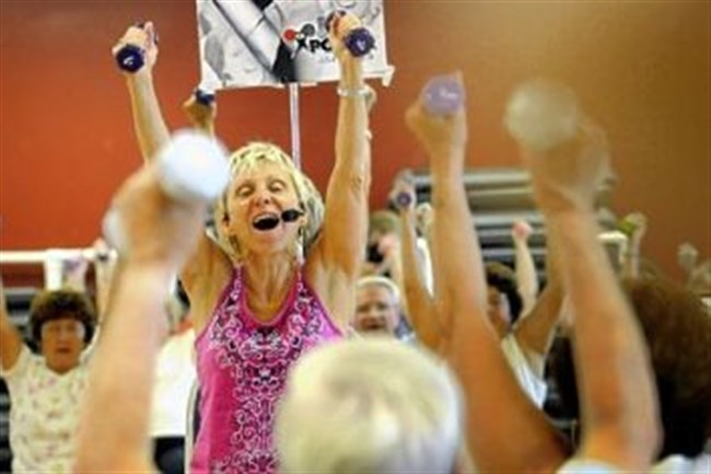 Instructor Anne Brucker leading a Silver Sneakers chair class at the Healthtrax Fitness and Wellness Center in Bethel Park.