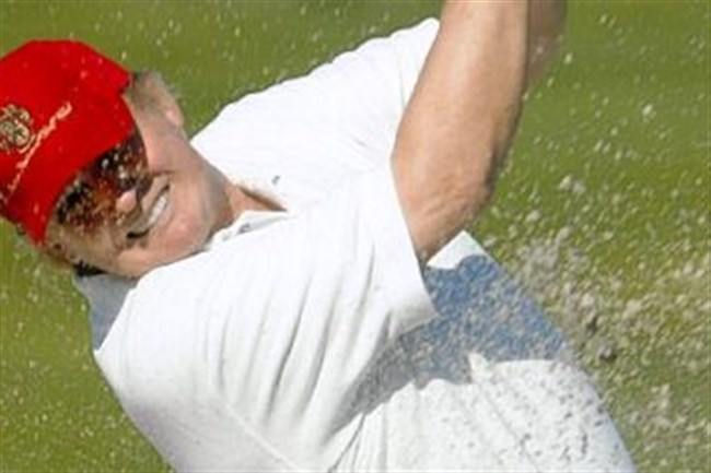 Donald Trump swings in his one acknowledged form of exercise.