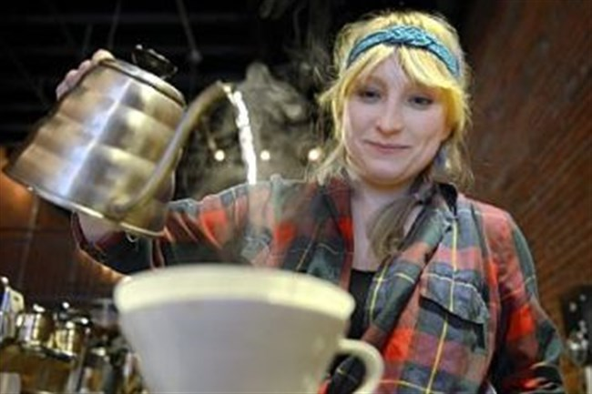 Rachel Grozanick brews a cup of Kenyan coffee at 21st Street Coffee and Tea in the Strip District.