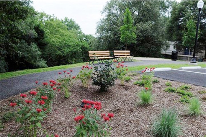Gardens The Upper McKinley Park entrance off Delmont Avenue in Beltzhoover was rededicated after a $250,000 renovation that included new benches, lighting, trail & parking surfaces and rain gardens.