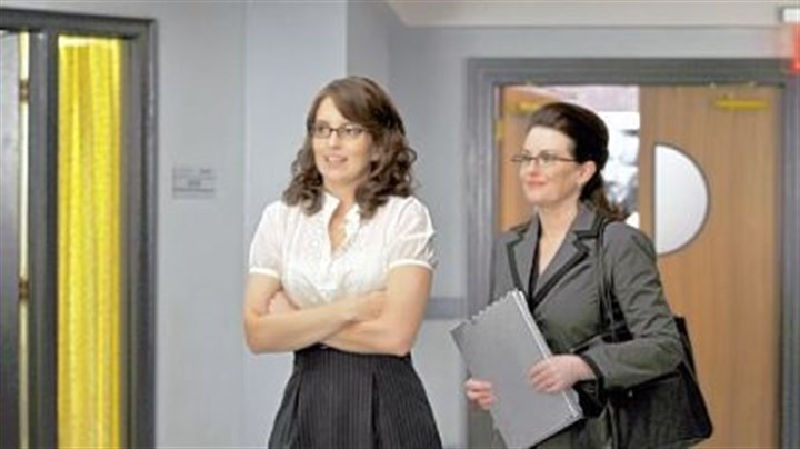 """30 Rock"" ""30 Rock"" returns tonight with Liz, left, played by Tina Fey, needing to impress an evaluator played by Megan Mullally when she decides she wants to adopt a child."