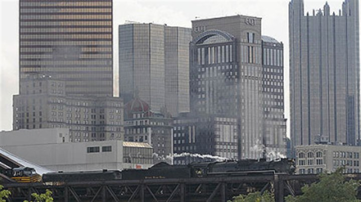 765 steam locomotive through downtown The 404-ton No. 765 steam locomotive of the Fort Wayne Railroad Historical Society leads its train carrying railroad enthusiasts Monday across the Fort Wayne Bridge over the Allegheny River from Downtown Pittsburgh. The David L. Lawrence Convention Center provides the backdrop.