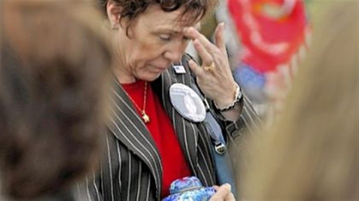 9/11 in Shanksville Deborah Borza, of Foxfire Village, N.C., carries an urn holding ashes of her daughter, Deora Bodley, a passenger aboard United Flight 93, to a remembrance service at the crash site in Somerset County.