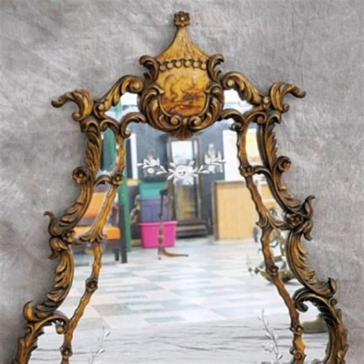 A Chippendale style chinoiserie A Chippendale style chinoiserie gesso mirror with cut glass.