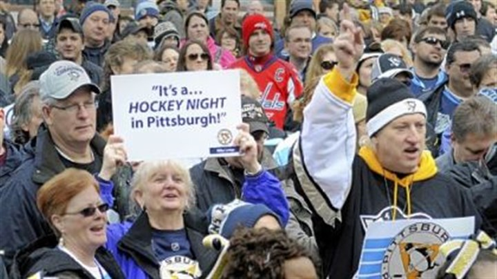 A Classic Pittsburgh hockey rally Patti Koerbel from Gibsonia (with sign) and Dan Zadach from Jefferson Hills (full Pens garb) were among the fans who thronged Market Square for the Penguins rally Thursday ahead of the Winter Classic against the Washington Capitals on Saturday.