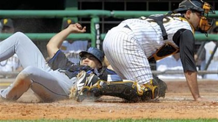 A slider Mets' Carlos Beltran slides safely into home plate against Pirates' Raul Chavel in the fourth inning.