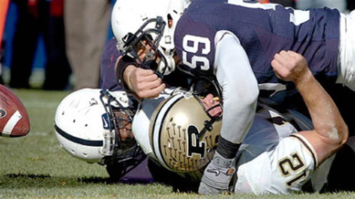 Aaron Maybin Penn State's Aaron Maybin forces a fumble by Purdue quarterback Curtis Painter late in a win yesterday at Beaver Stadium as the Nittany Lions' defense help preserve their seventh victory of the season.
