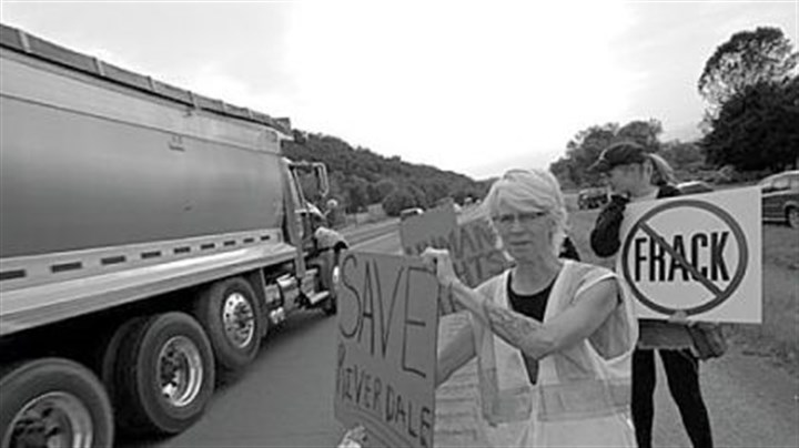Activist Wendy Lynne Lee Activist Wendy Lynne Lee takes the protest to Route 220 in front of the Riverdale Park, where much of the passing truck traffic is related to natural gas well development.