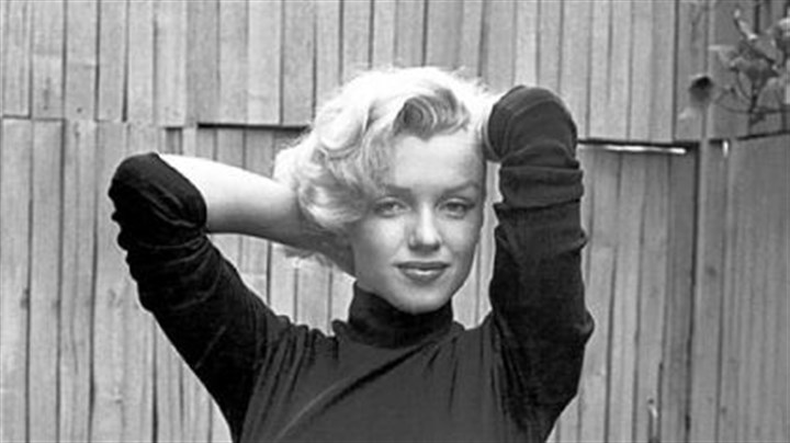 """Actress Marilyn Monroe Playfully Elegant at Home"" Alfred Eisenstaedt's 1952 ""Actress Marilyn Monroe Playfully Elegant at Home"" will be part of the ""Marilyn Monroe: Life as a Legend,"" opening at the Warhol Oct. 23."