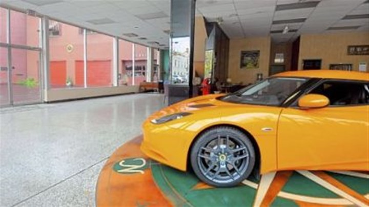 Adieu, Ascot A Lotus Evora remains in the almost empty showroom at Ascot Imported Cars in Sewickley.
