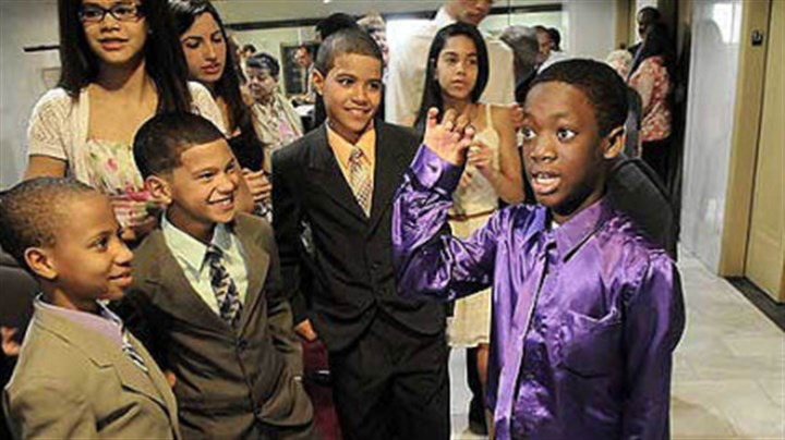 Adoption Fekens Dusch, 12, of Bon Air, shows his dance moves to the Owens brothers, from left, Kensly, 9, Gavin, 8 and Ayden, 11, after his adoption process at Allegheny County Orphans Court today.