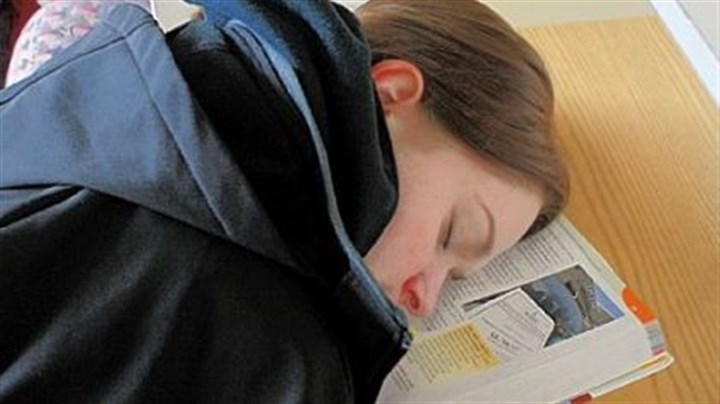 After an 'all-night' study session Samantha Schafer, 20, a freshman business major at Community College of Allegheny County, sleeps in the school library on the Allegheny campus last month. She spent the entire night studying.