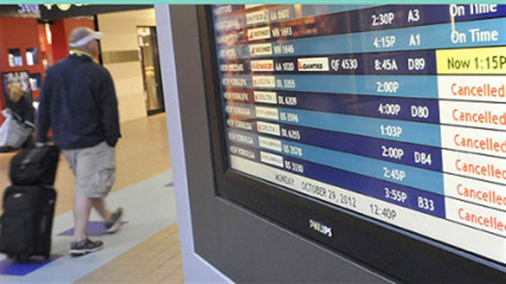 airport flights canceled board Information boards in the airside terminal at Pittsburgh International Airport show that most of the departures for East Coast cities have been cancelled today because of Hurricane Sandy.