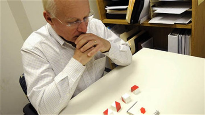 Alan Romatowski takes a cognitive test Alan Romatowski, who has early-onset Alzheimer's disease, attempts to arrange blocks into a pattern during a recent test at the University of Pittsburgh Alzheimer Disease Research Center at UPMC Montefiore in Pittsburgh.