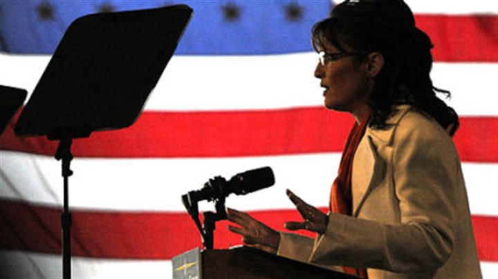 Alaska Gov. Sarah Palin Backed by an American flag, 