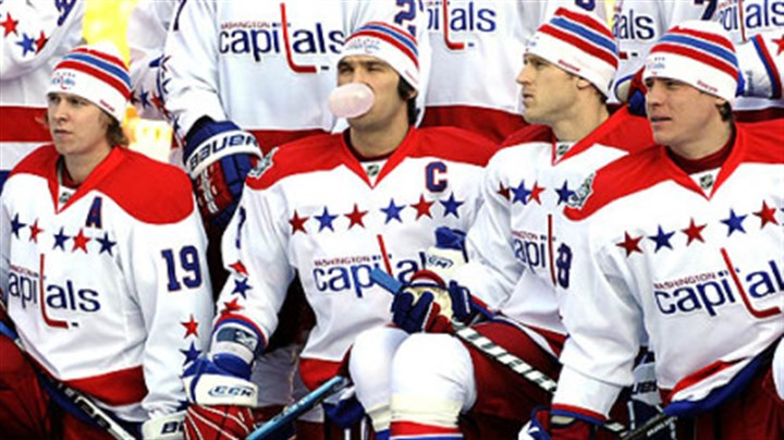 Alex Ovechkin Capitals captain Alex Ovechkin makes use of his bubble gum Friday during a team photo at Heinz Field.