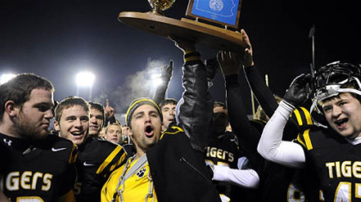 Alex Papson Injured North Allegheny running back Alex Papson holds the trophy after his team defeated La Salle College in the PIAA Class AAAA championship game at Hersheypark Stadium in Hershey, Saturday.
