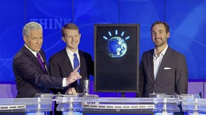 "Alex Trebek, Ken Jennings and Brad Rutter ""Jeopardy!"" host Alex Trebek, left, with contestants Ken Jennings, center, and Brad Rutter and an IBM computer named Watson."
