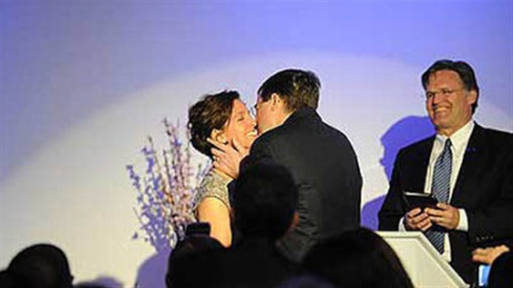 Alexander/ALS Neil and Suzanne Alexander kiss after renewing their vows during a ceremony officiated by Pastor Chris Taylor.