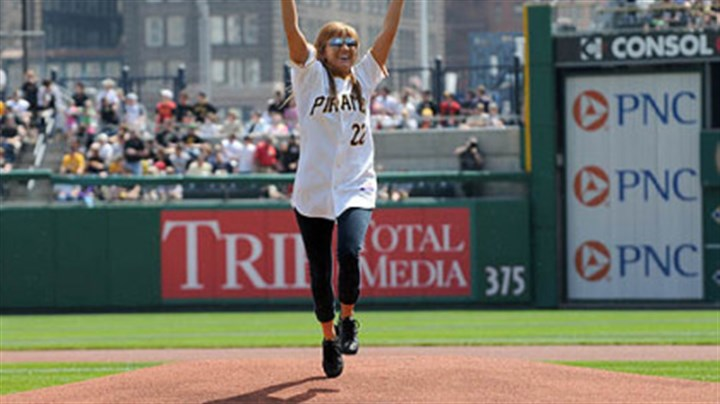 Ali McMutrie Ali McMutrie of Ben Avon Heights throws out the first pitch at the Pirates season opener against the Dodgers at PNC Park, Monday. McMutrie and her sister Jamie brought a number of orphans from earthquake-ravaged Haiti earlier this year.