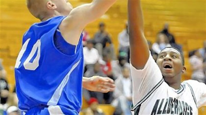 Allderdice Allderdice High School's Deion Nesbitt goes up to block a shot by Perry's Andrew Forse in the City League championship game at the Palumbo Center.