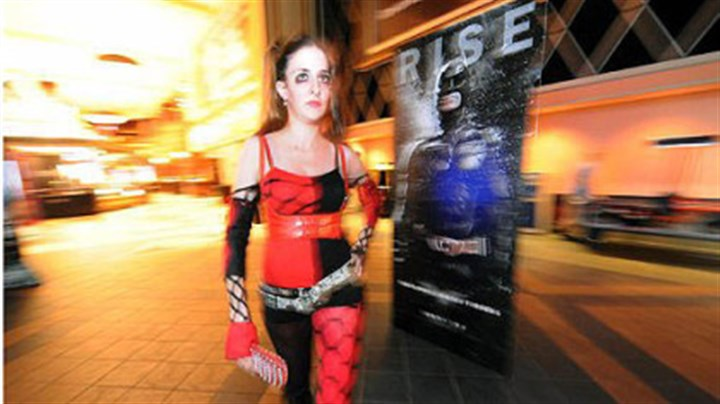"Amanda Kitchen Amanda Kitchen, 22, of White Oak makes an early entrance as ""Harley Quinn,"" a Batman character, to the midnight showing of ""The Dark Knight Rises."""