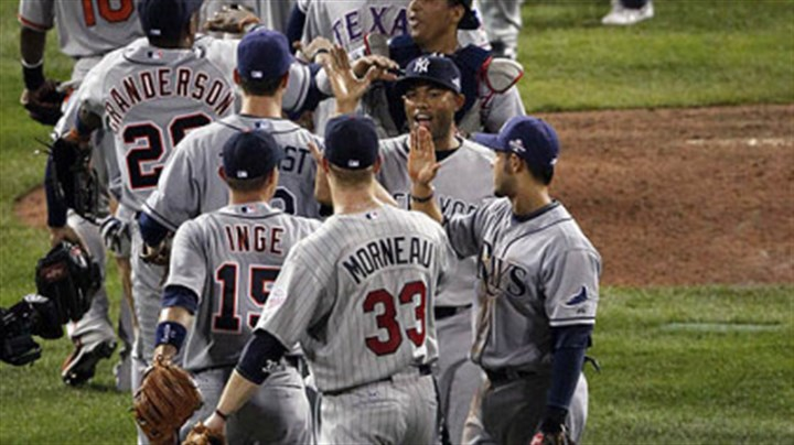 American League American League players congratulate each other after defeating the National League, 4-3.