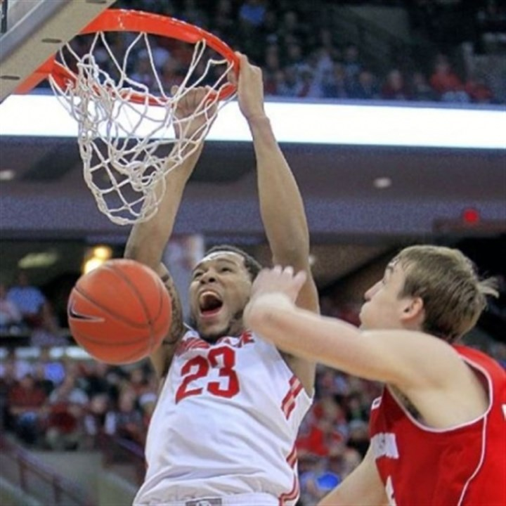 AmirWilliams Ohio State's Amir Williams, left, dunks over Wisconsin's Sam Dekker in the second half of the Buckeyes' 58-49 Big Ten victory Tuesday night in Columbus, Ohio.