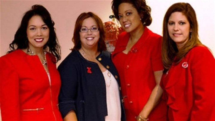 Amy Heinl, Wendy McCabe, Candy Castleberry-Singleton and Jill Sandilla Amy Heinl; Wendy McCabe, American Heart Association's Go Red For Women director; Candy Castleberry-Singleton; and Jill Sandilla, Go Red Luncheon chair.