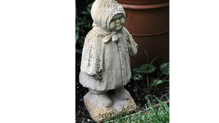 An antique garden ornament A small statue in Basil Cox's Squirrell Hill garden.