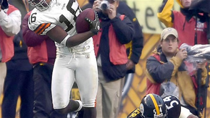 Andre Frazier and Browns Joshua Cribbs Browns kick returner Joshua Cribbs stays in bound in front of linebacker Andre Frazier as he runs a kickoff back for a 100-yard touchdown late in the game. (vs. Browns 11/11/07)