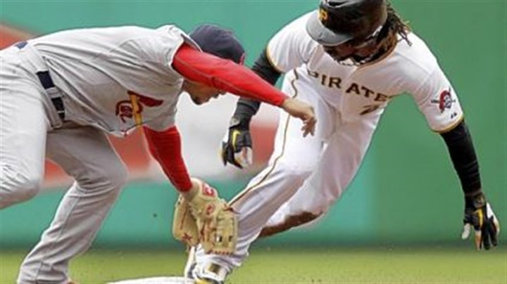 Andrew McCutchen Andrew McCutchen, right, steals second ahead of the tag by Cardinals shortstop Rafael Furcal Sunday at PNC Park.