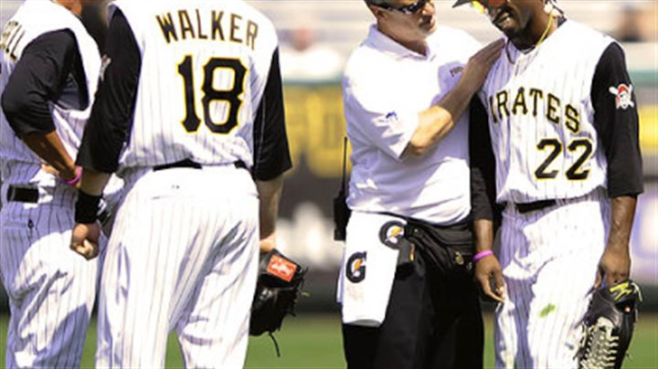 Andrew McCutchen has his shoulder checked out The Pirates' Andrew McCutchen has his shoulder checked by athletic trainer Brad Henderson Sunday at PNC Park.
