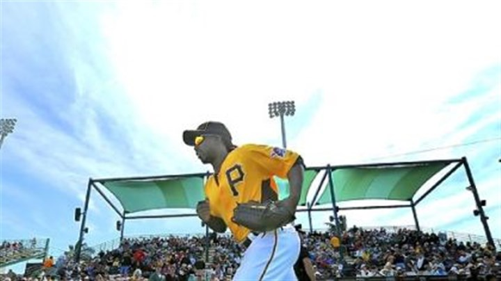 Andrew McCutchen runs Andrew McCutchen runs on to the field for the Pirates home exhibition opener Sunday at McKechnie Field in Bradenton, Fla.