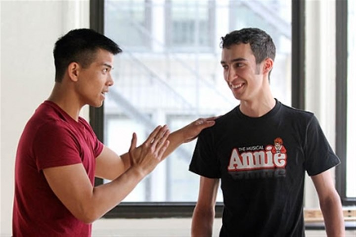 "Angelo Ragghianti at the Jimmys Telly Leung, left, whose most recent Broadway appearance was in the revival of ""Godspell,"" works with Pittsburgh CAPA's Angelo Ragghianti during the week leading up to the National High School Musical Theater Awards on Monday."
