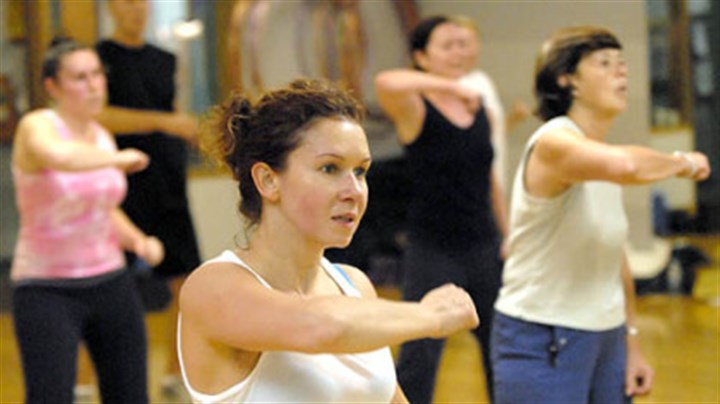 Anna Uskova Anna Uskova, center, works out at Maria McCalister's Zumba aerobics exercise class at Club 1. An anesthesiologist at UPMC Shadyside, Dr. Uskova also lifts weights and takes yoga.