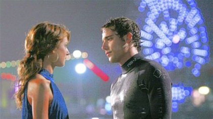 "Annie and Ethan Shenae Grimes as Annie and Dustin Milligan as Ethan in ""90210."""