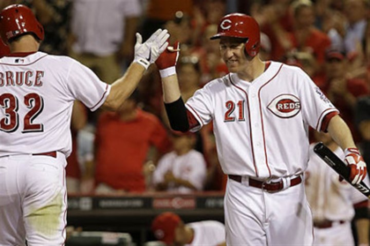Another home run The Reds' Jay Bruce is congratulated by Todd Frazier after Bruce's solo home run off Pirates relief pitcher Bryan Morris in the eighth inning.