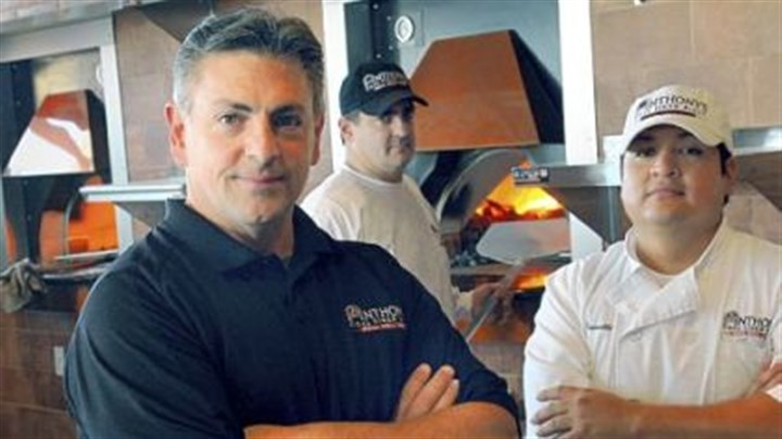Anthony's Coal Fired Pizza From left, general manager John Mowod and managers Jay Petroy and Carlos Trivelli of Anthony's Coal Fired Pizza in Robinson. The restaurant opens Saturday.