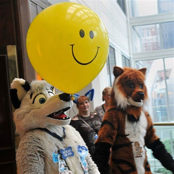 anthrocon smiling balloon Duncan the Dog, who is also Thomas from Walnutport, Pa., balances a balloon on his nose on the third floor of the Westin Convention Center Hotel today.
