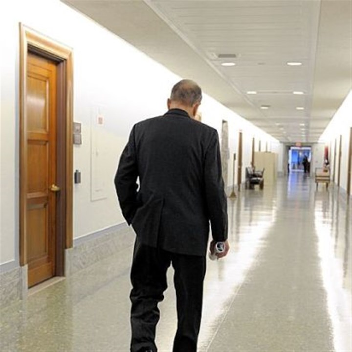 Arlen Specter walks Arlen Specter walks down the hall of the Dirksen Senate office building in 2009.