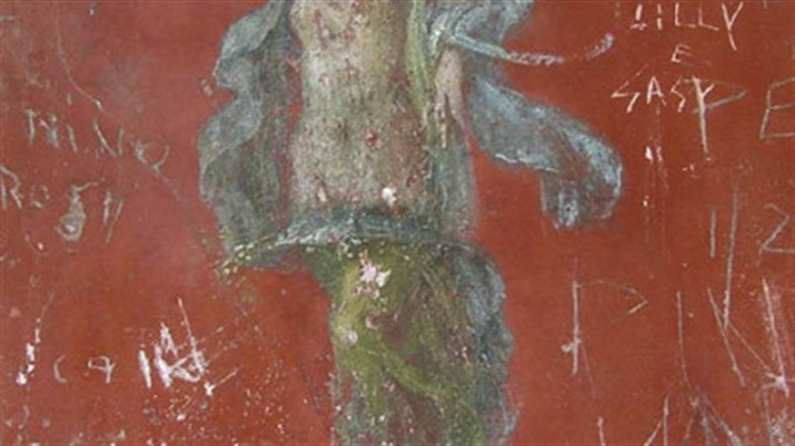 Artwork Pompeii is so well preserved that some of its artwork, such as this delightful fresco of a dancing woman in the House of the Lararium of Achilles, is clearly visible. But as the modern graffiti makes clear, not everyone sees its value.