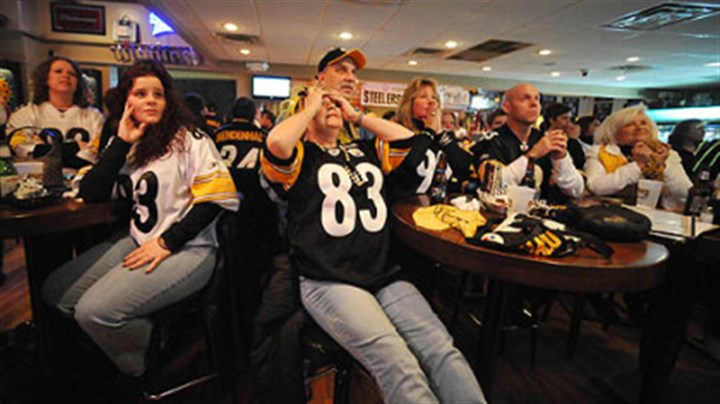 At Hough's in Greenfield June Hough Repic, of Greenfield, center, covers her eyes while watching with husband Tony and other family members, Lisa Morgavo, Nick Egidlo and Janie Medjimorec at Hough's bar in Greenfield, where Green Bay Packers coach Mike McCarthy was raised.