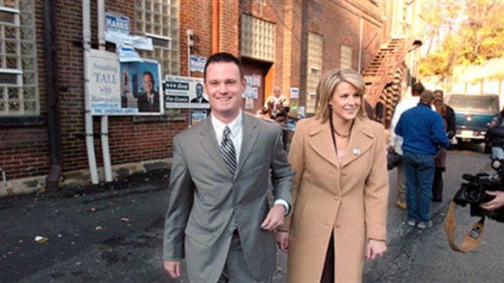 At the polls Mayor Luke Ravenstahl and his wife Erin leave St. Boniface's, along East Street, after voting earlier yesterday.
