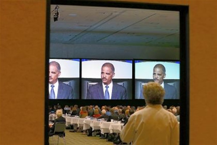 atty gen Eric Holder Attorney General Eric Holder is seen on video screens as he speaks Monday during the 2013 America Bar Association annual meeting in San Francisco.